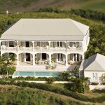 Private hilltop setting provides constant cooling breezes and spectacular ocean views